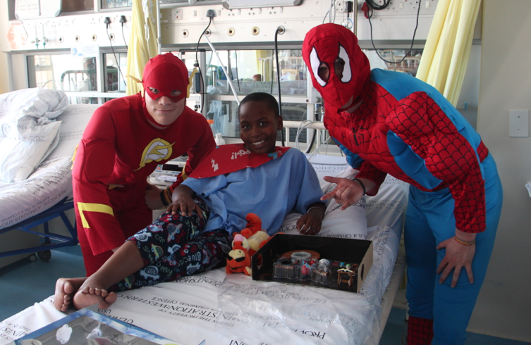 Super Heroes abseil off the Red Cross Children's Hospital