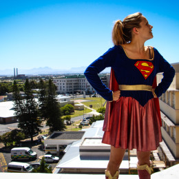 Tessa Abseil as super hero off Red Cross No Danger Diaries